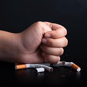 Male Hand Crushing Cigarettes